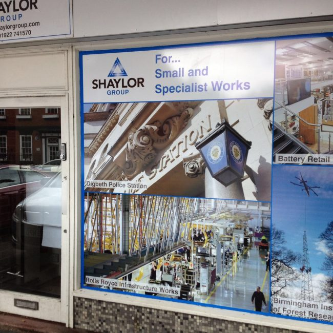 A close up of a shop front that has window film installed
